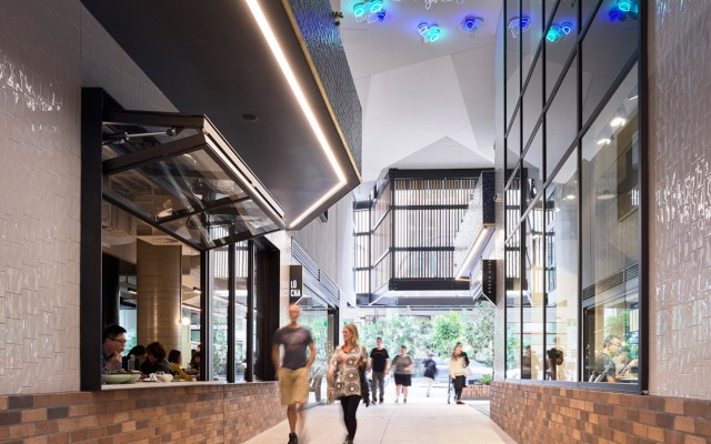 Student housing towers revive historic arcade